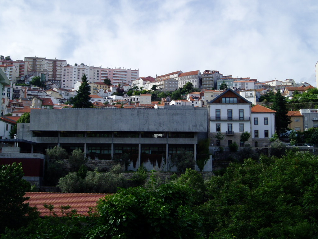 This is the University of Beira Interior main library, the concrete building plus the white building at the right of it.